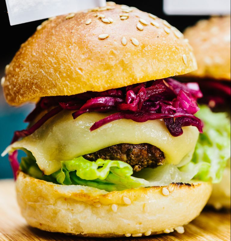 close up of BBQ beef burger with cheese and red cabbage