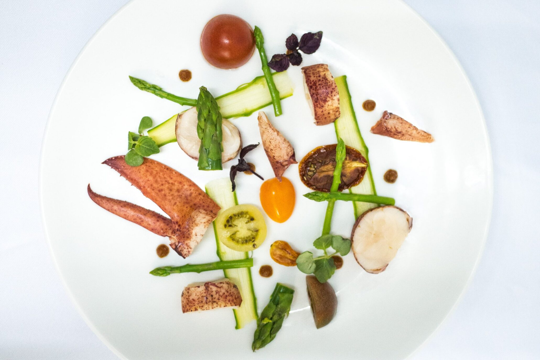 Hong Kong Personal chef's lobster and vegetables on a white plate