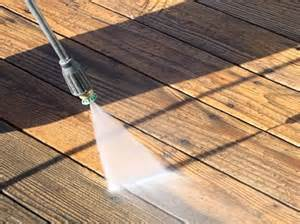 cleaning out the gutters before the fall leaves begin their damage