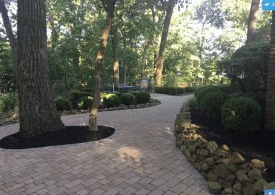 Brick walkway w rock border