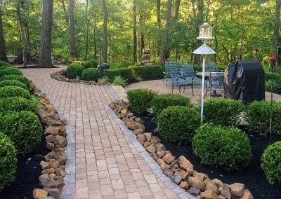 Brick patio and walkway w rock border
