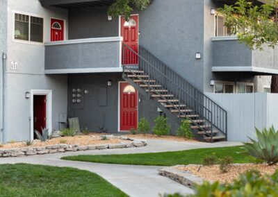 Two story apartments with red doors