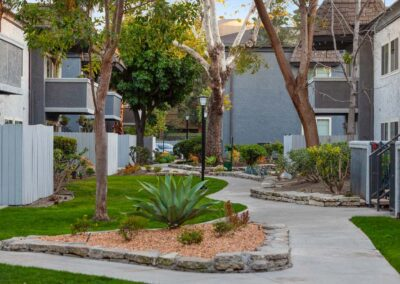 Pathways with landscaping alongside apartments