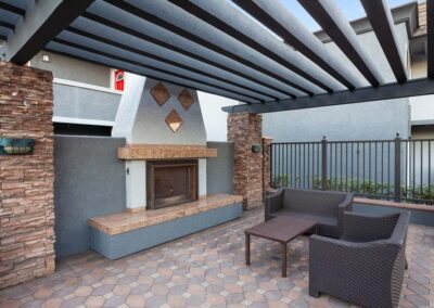 Outdoor fireplace on a brick style floor with seating