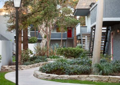 Pathways through apartment complex with grass and trees
