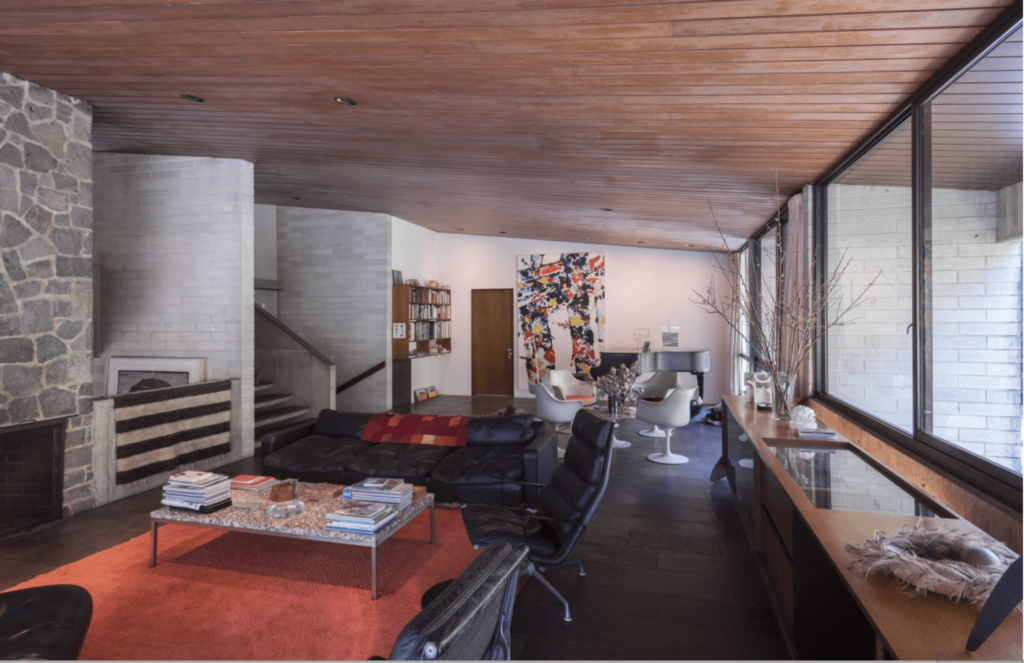 The living room with a Sam Francis painting titled 'Not Yet Thought' (1975) and Eero Saarinen chairs