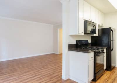 Empty Kitchen and Dining Room with appliances