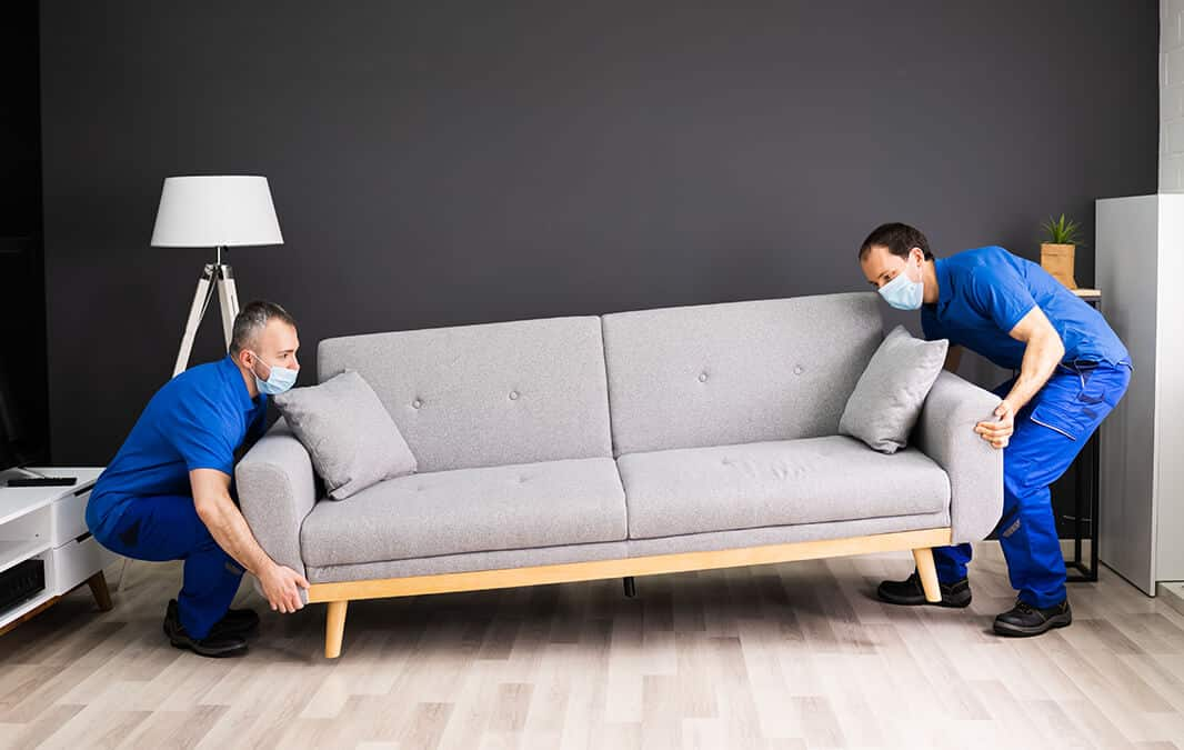 movers carrying couch