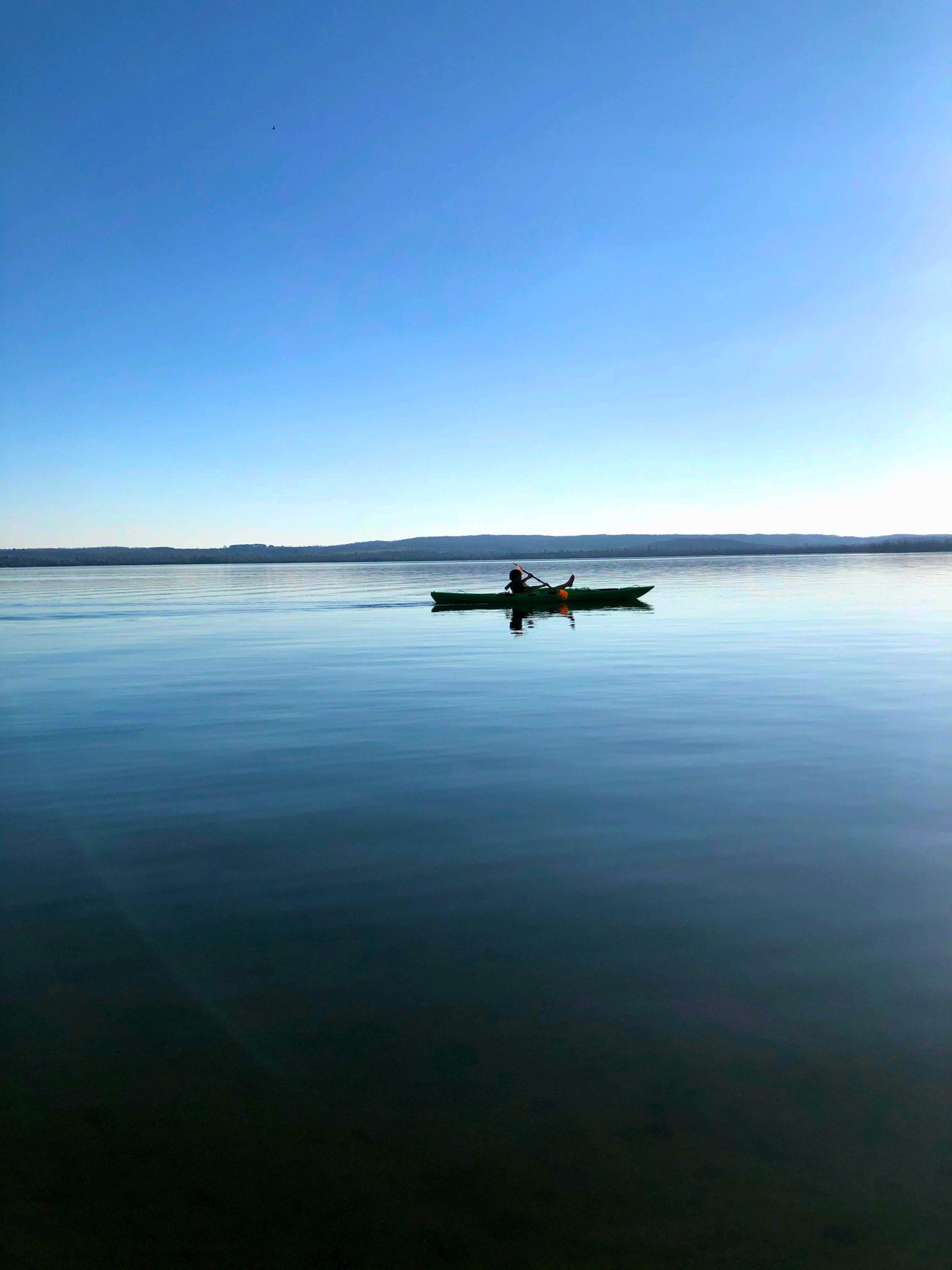 person kayaking in the lake