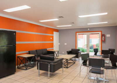 Apartment clubhouse with orange wall