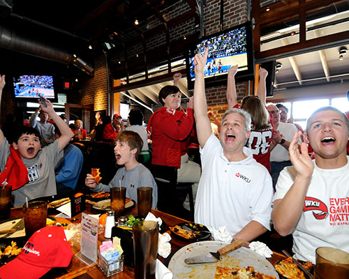 WKU Basketball fans cheering at Double Dogs Bowling Green.