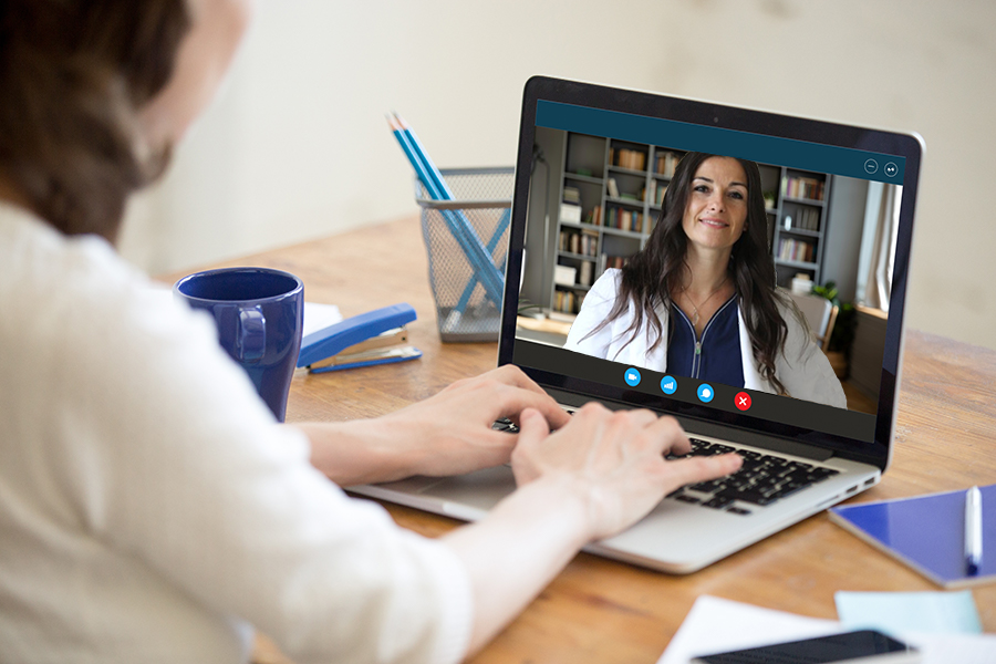 Female talking to a woman over a video call on her laptop