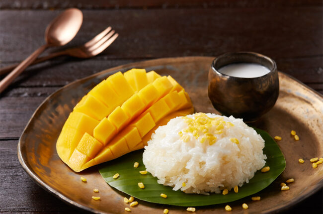 Mango Sticky Rice with a mango on a plate
