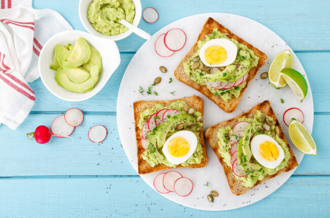3 slices of avocado toast with hard boiled eggs