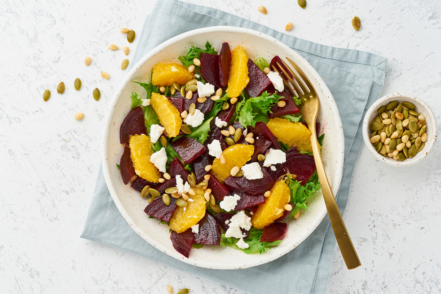 Salad with oranges, beets, seeds, and cheese