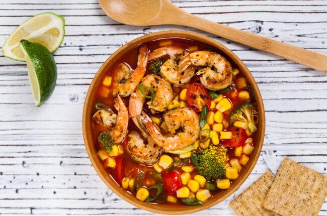 Bowl of shrimp, corn and tomato soup