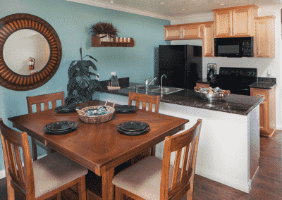 Furnished kitchen and dining room with decor and blue wall