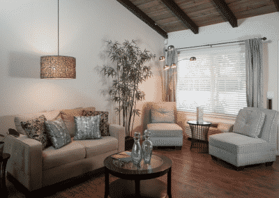 Furnished living room with windows and decor