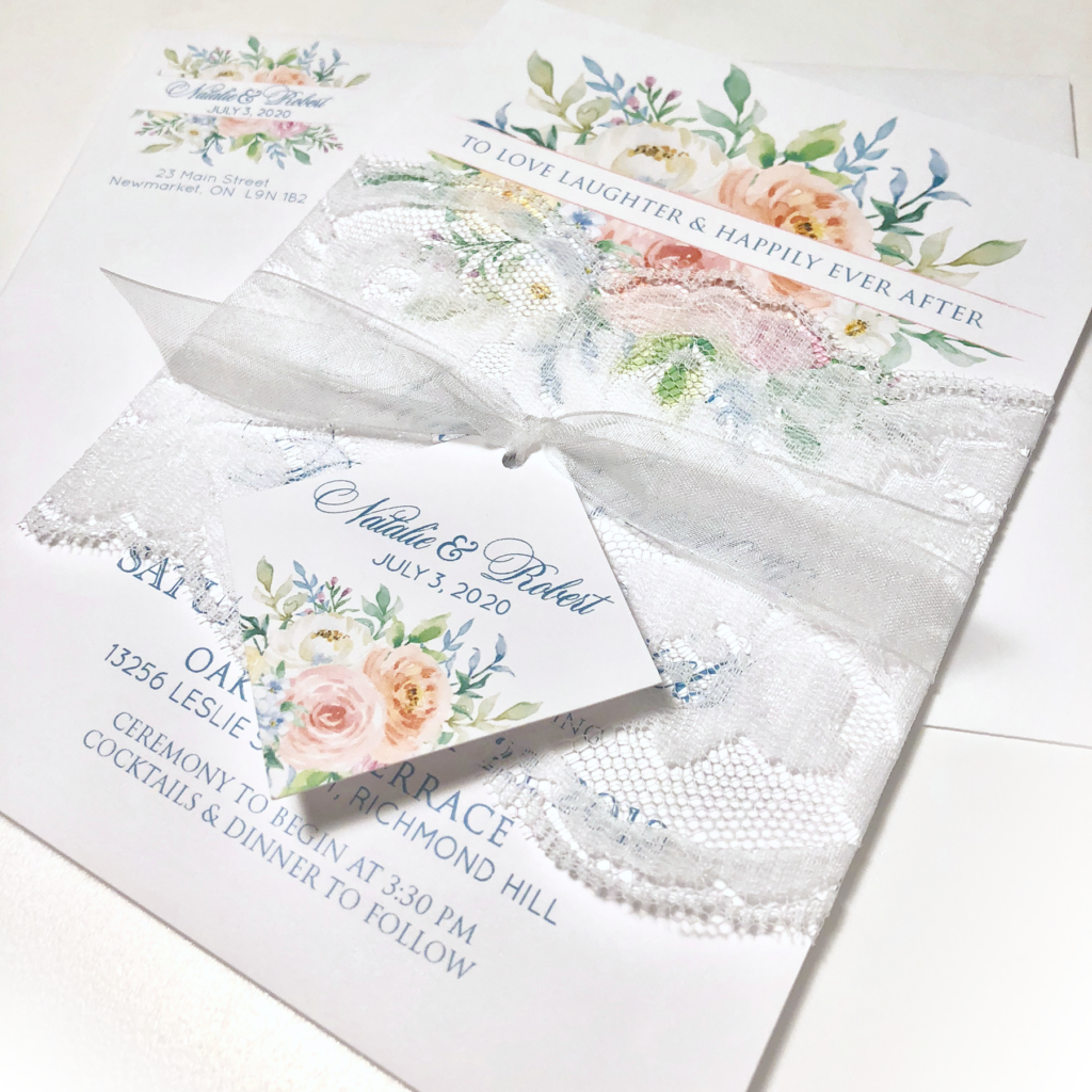Watercoloured flowers and lace wedding invitation