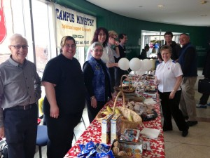 A group of volunteers from The Salvation Army have food set out on a table to serve to Algonquin College students.