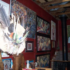 The art-covered walls of the Outsider Cafe.