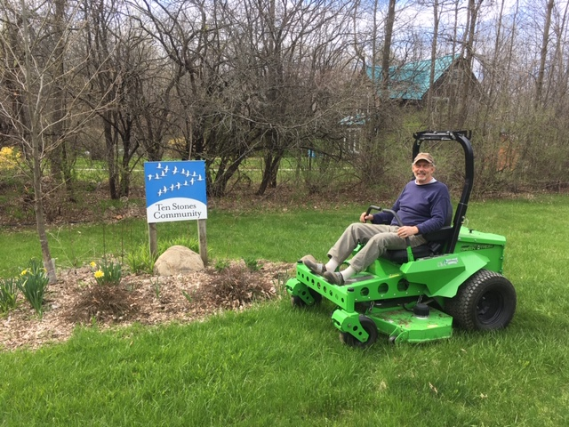 Ten Stones Village Association using Mean Green Electric Mower