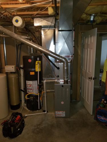 Furnace in basement and toolbag