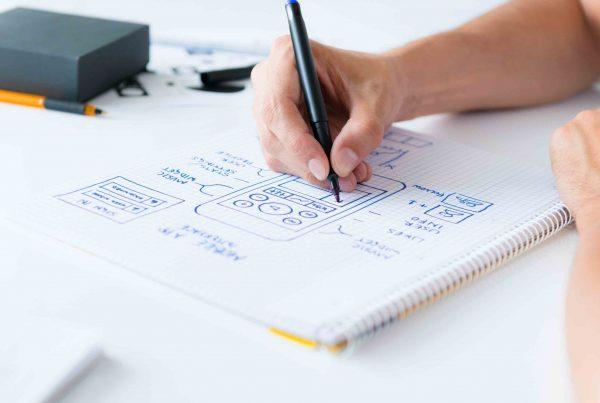 Software designer sketching a mobile interface