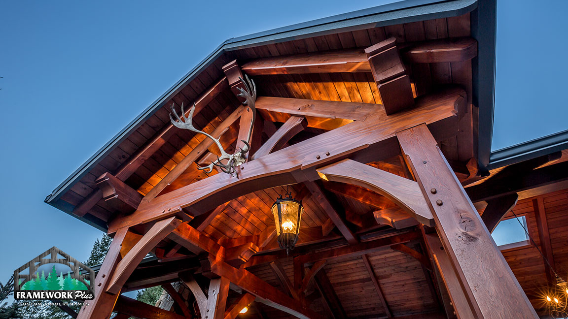 Dark wood 18' x 30' timber frame pavilion kit featuring handcrafted king post trusses designed by timber pavilion kit company Framework Plus in Estacada, OR