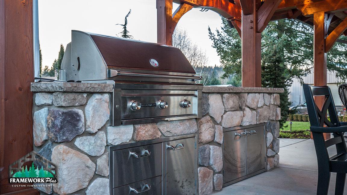 Outdoor grill inside the MT. Hood Timber Frame Pavilion built by gazebo builder Framework Plus in Portland, OR