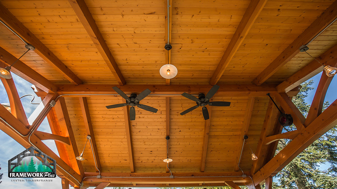 Close-up view of the ceiling of a Timberline pavilion kit with tongue and groove wood ceiling designed by timber entryway building company Framework Plus in Estacada, OR