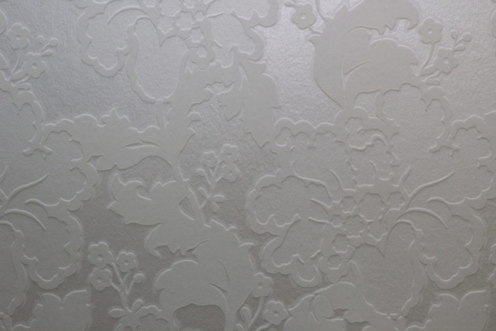 I used lots of textured white on whites like this stunning flock wallpaper