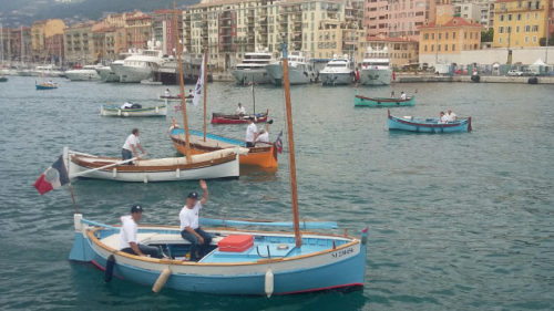 """Parade of """"pointus"""" fishing boats during the Nice Festival du Port 2018."""