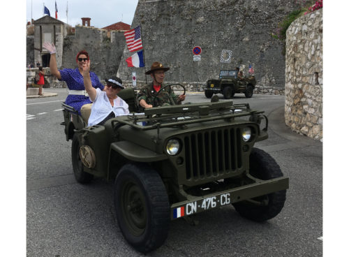 American jeeps with pin-up girls parading through the streets of Villefranche-sur-mer. July 4, 2018