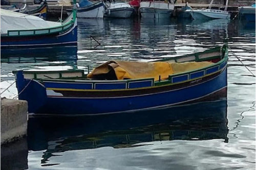 Traditional fishing boat, Marsalforn harbor. Gozo, Malta