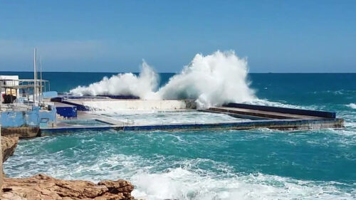Storm waves washing into Sliema Pitch pool, Malta