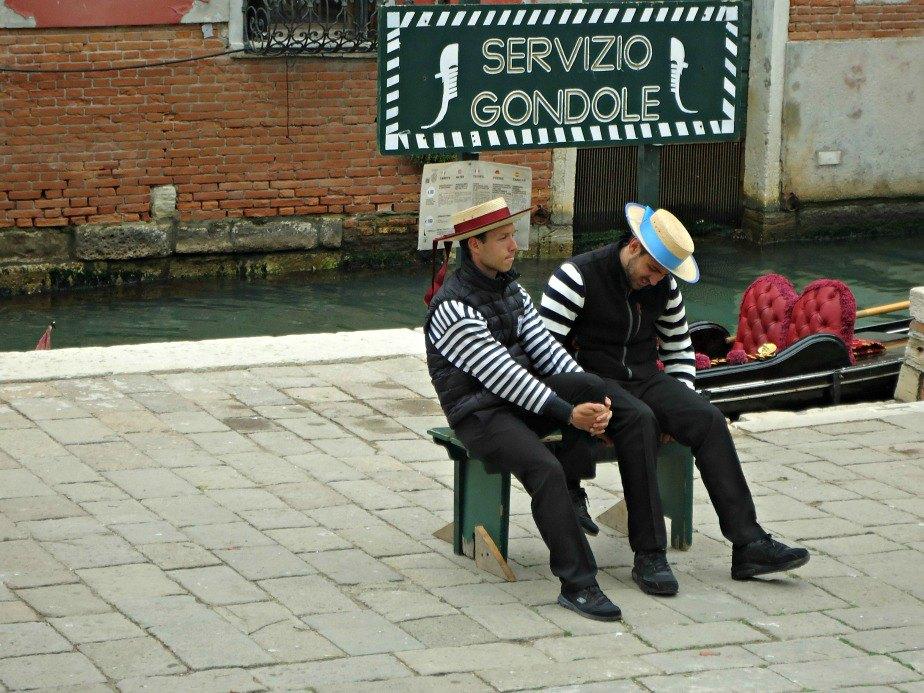 Gondoliers on a Break in Venice