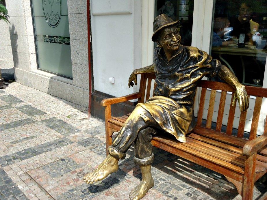 Bronze Man Sitting on a Bench in Wencelas Square Prague