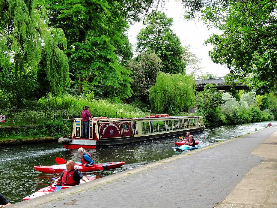 Kayakers and Long Boats