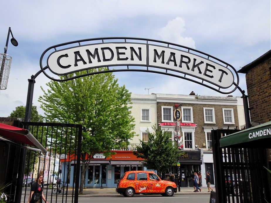 Bright Orange Taxi passing Camden Market