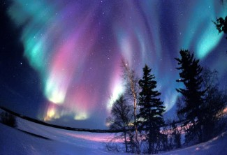 Auroral Mystery Solved: Auroras Caused by Charged Particles