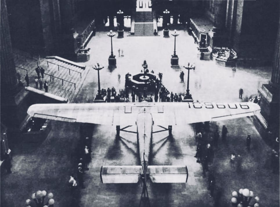 """Ford Tri-Motor """"City of New York"""" at hall NYC Pennsylvania station, - US History of Tourism - TAT - Lindbergh Line - First Coast to Coast Flight"""