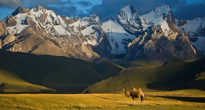 Ancient Silk Road between China and the Mediterranean. The Tian Shan mountains surrounding the old caravan route dominate the country and are home to snow leopards, lynx, horses and sheep, among others.