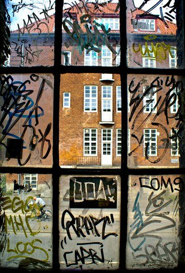 Graffiti shown on a window that could be easily fixable, if it had 3M Anti-graffiti film installed