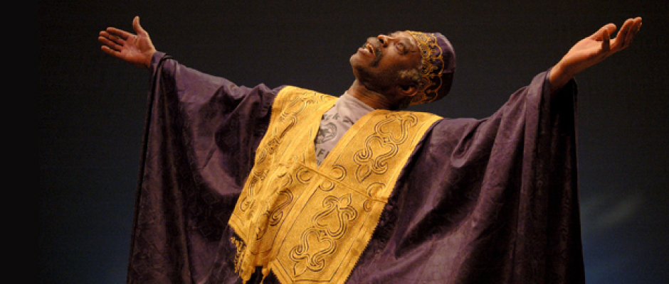 Carlyle in a traditional purple and gold African dress