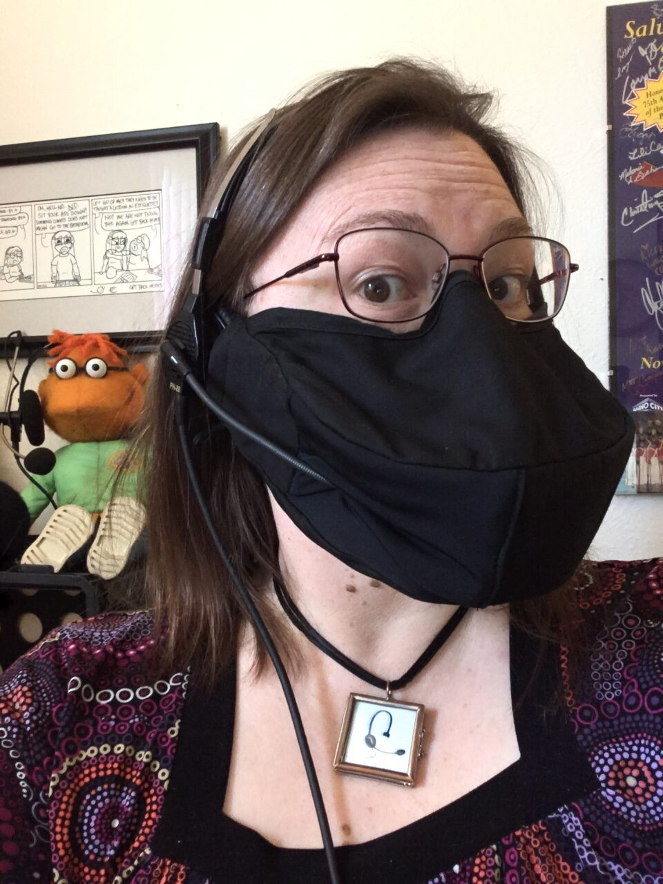 Stage Manager Erin Joy Swank wears a mask designed for headset use