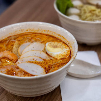 Laksa is a spicy noodle soup popular in Peranakan cuisine of Southeast Asia Singapore