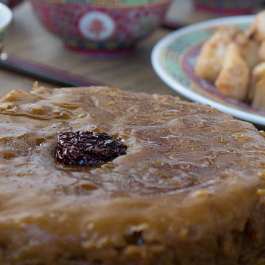 Traditional Chinese New Year's cake.  It is a steamed cake prepared with glutinous rice flour, dates and brown sugar.