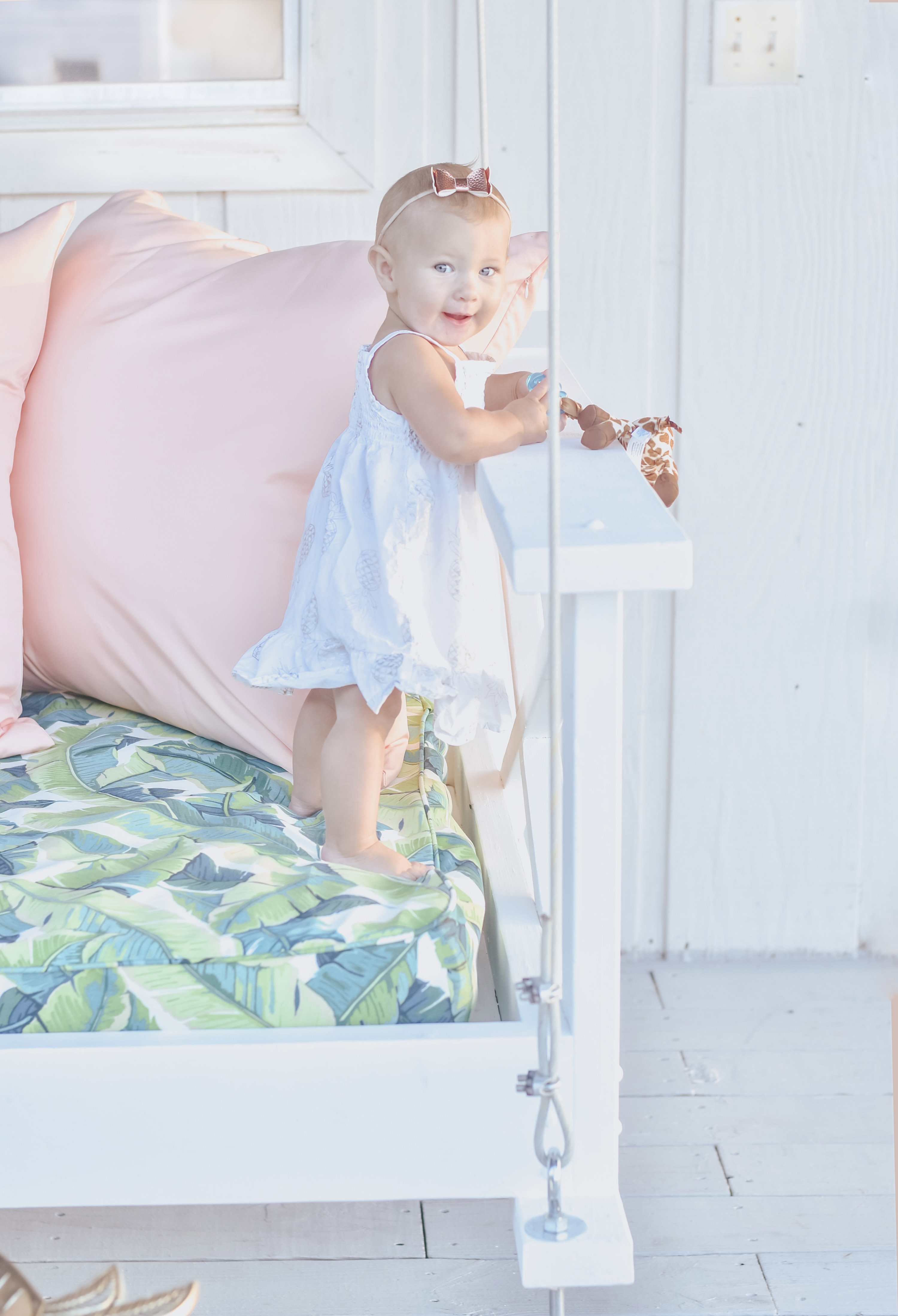 Jami Ray's chic swing bed on the dock by Nate and Lane - Collins standing