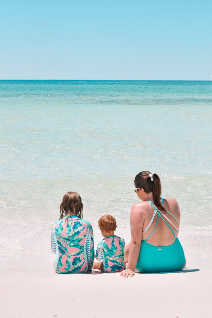 30A Mama wearing Cabana Life swimsuits on white sand - mommy and me